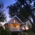 """The Crib"" Offgrid Retreat With Retractable Garage Style Facade"