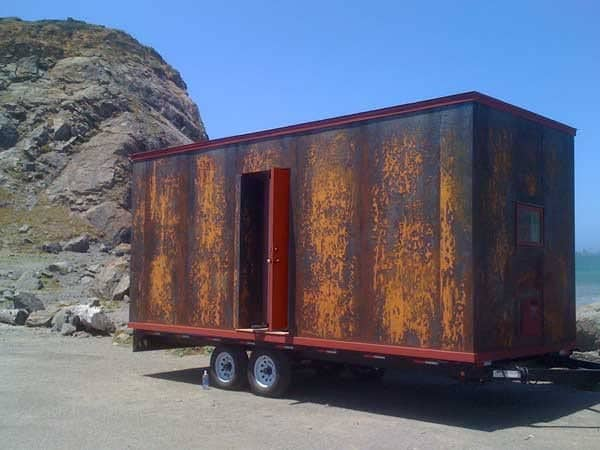 """The """"Mica"""" design by Tumbleweed uses a hot rolled weathered steel siding for a completely unique look."""