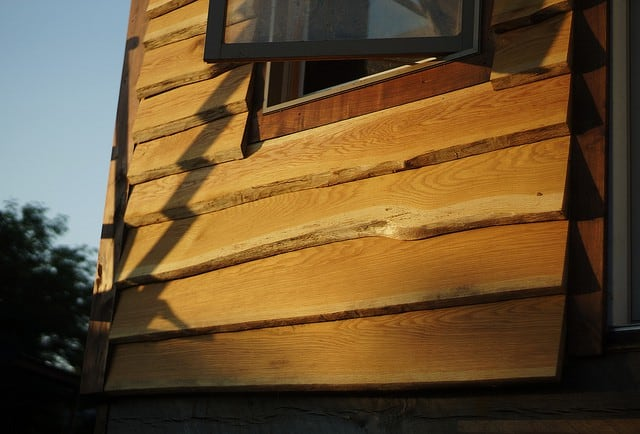 """Wavyboard"" siding, shown here, uses natural edges to create a distinctly rustic style of clapboard."
