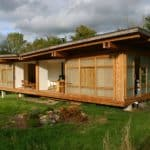"""Huge Sliding Windows Let This """"House in the Meadow"""" Breathe In Its Surroundings"""
