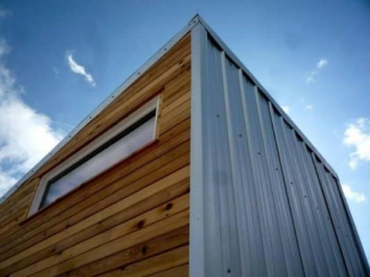 You have many options when it comes to siding, from metal to wood, or a combination of both.