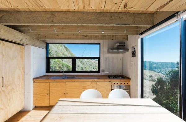 53d700bbc07a80d97100016a_2-hermanos-cabin-wmr-arquitectos_sergio_3hermanos_599-1000x661