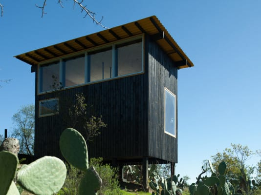 The 'Charred Cabin' Provides Essential Living in the Harsh Desert