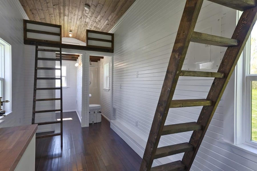 The loft provides a generous 224 square foot layout for Tiny houses plans with loft