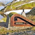 Tiny Green-Roofed Cabin Hides In Remote Mountain Setting