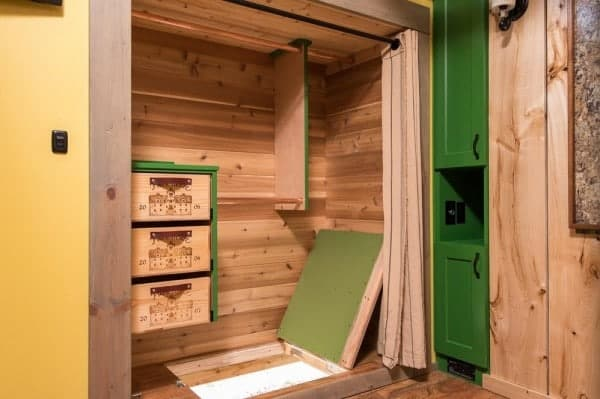 Jerry-and-Rene-Slide-Out-Tiny-House-Escape-Hatch-600x399