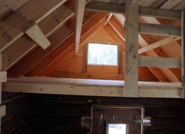 man-builds-tiny-log-cabin-for-500-bucks-011-600x435