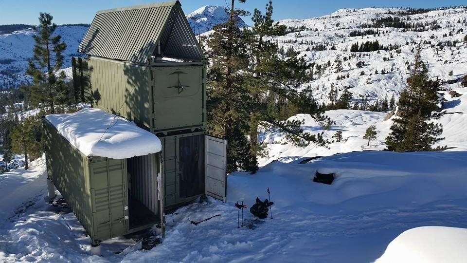 3 shipping containers form a private offgrid home in tahoe for Off grid cabin foundation