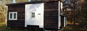 After living in a dorm, her tiny house feels huge