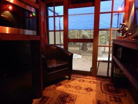 Cargo trailer hides a cozy den for the nomadic bachelor