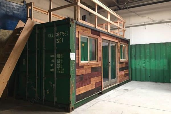 Schnippering's shipping container is an artistic welcome to shanty town