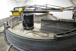 Mobile 3D printer creates 400sf house onsite in 24 hours