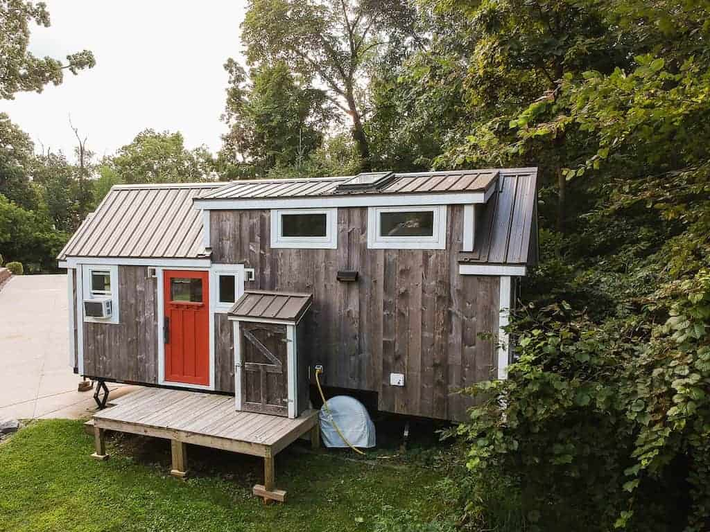 Tiny Home Designs: Bespoke Park Model RV Home Built From A Train Caboose