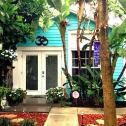 Classic Florida style: Palm Beach bungalow on a subtropical garden lot