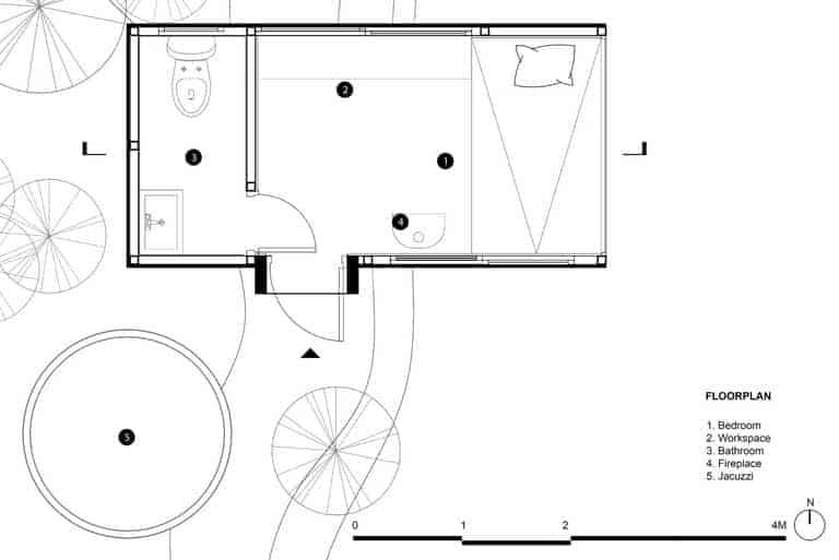 glass walled cabin built on stilts