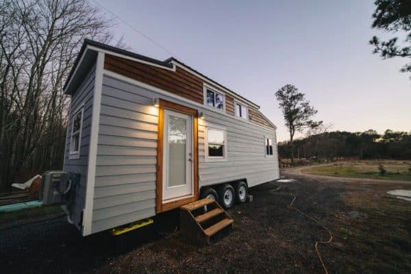 "A 28-foot ""modern farmhouse"" with a first-floor bedroom and pass-through bathroom"